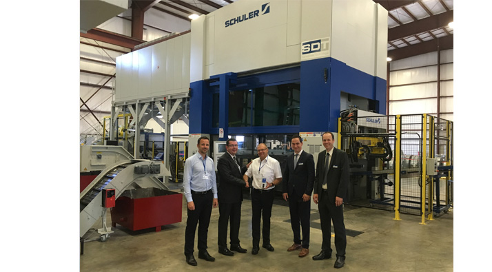 "A Schuler press guarantees reliability in the machinery pool"", says Marcel Wegmann (second from the right)."